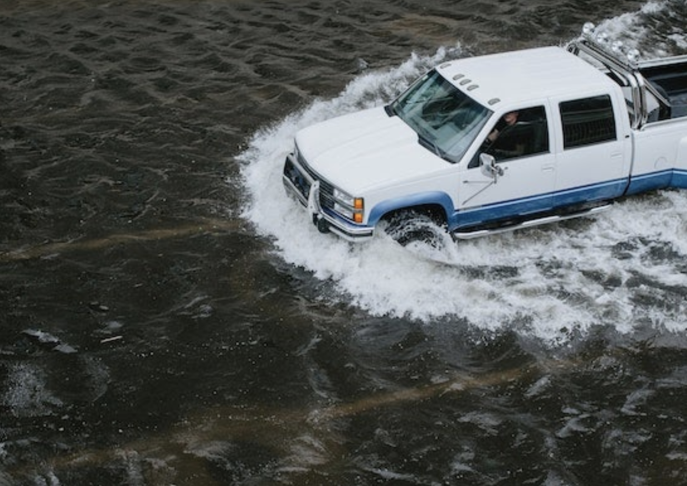 car going through water
